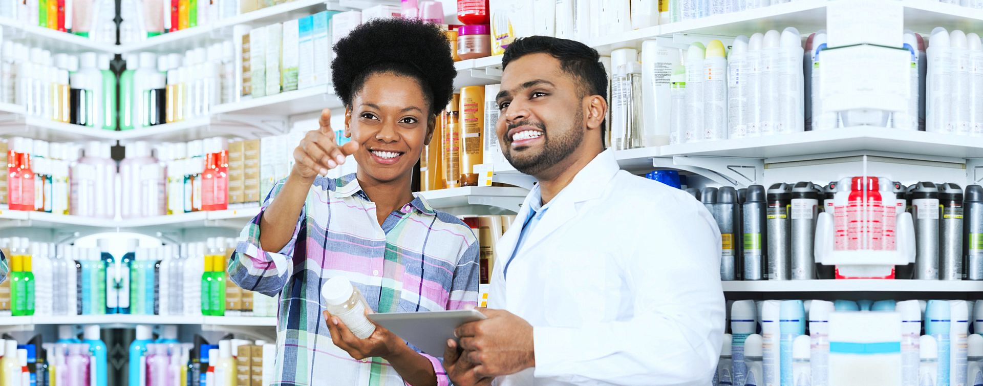 pharmacist and customer looking for something